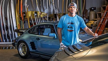 Porsche Robby Naish next to his 911 Carrera S (Type 991) and 911 S from 1977