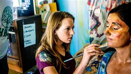 (l. - r.) Artist Alexa Meade paints on author Helene Laube