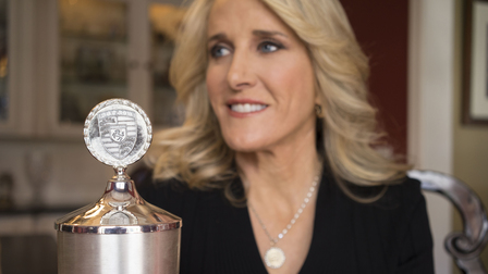 Porsche Tracy Austin and her winner's cup